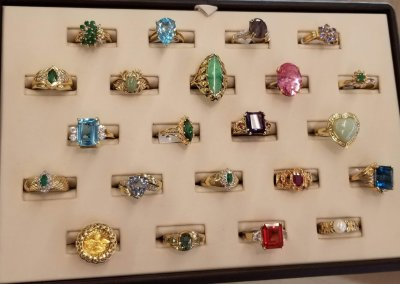 Assorted emerald, diamond, topaz rings